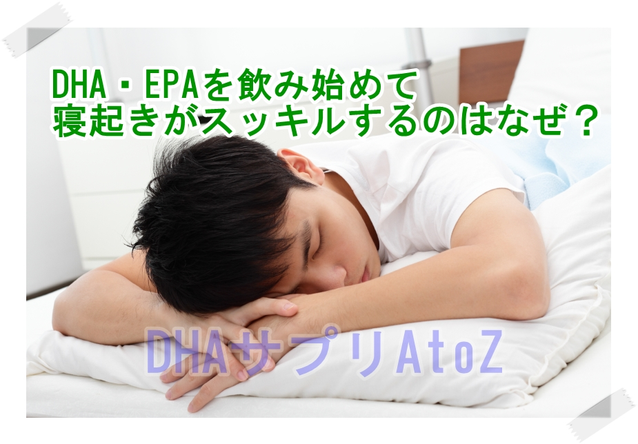 A young Asian man sleeping on a bed